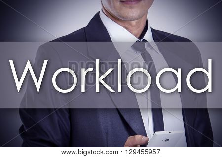 Workload - Young Businessman With Text - Business Concept
