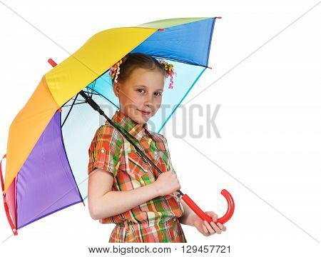 Cute fashionable teen girl with iridescent umbrella looking at the camera