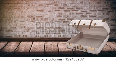 Open suitcase against wooden floor