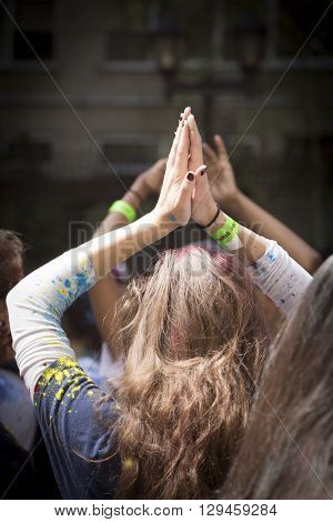 NEW YORK - APR 30 2016: A spectator dancing at NYC Bhangra displays the Anjali mudra, a hand gesture meaning divine offering, at Holi Hai Festival of Colors in New York, April 30 2016.