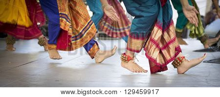NEW YORK - APR 30 2016: Ghungroo bells on the feet of dancers from NYC Bhangra performing on stage in traditional clothes at the Holi Hai Festival of Colors in New York on April 30 2016.