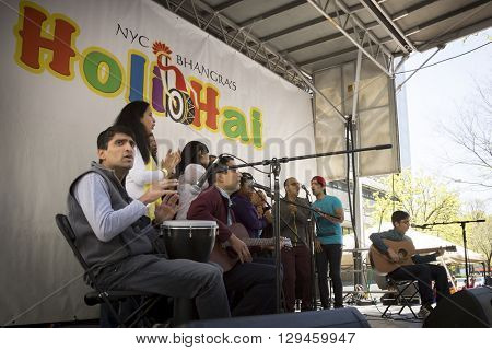 NEW YORK - APR 30 2016: Musicians perform on stage at the Holi Day Festival of Colors in Dag Hammerskjold Plaza hosted by NYC Bhangra in New York on April 30, 2016.