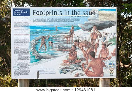 KNYSNA SOUTH AFRICA - MARCH 5 2016: An information board at the beach in Noetsie describing the history of humans on the coast of South Africa