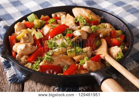 Chicken Saute With Mushrooms, Peppers And Zucchini Closeup On A Pan. Horizontal