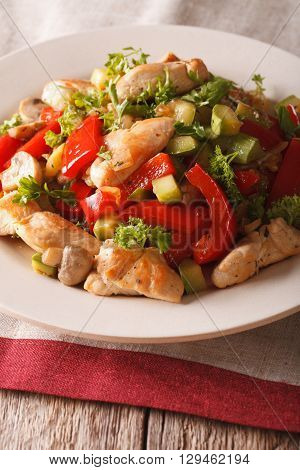 Chicken Saute With Mushrooms And Vegetables Close-up. Vertical