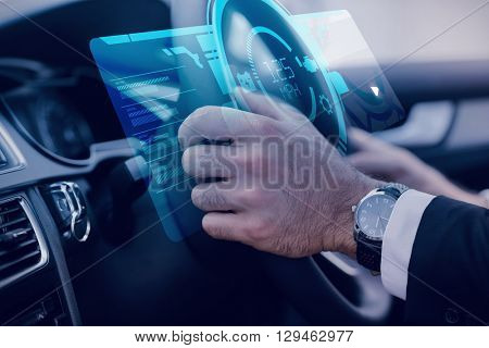 A watch against businessman in the drivers seat