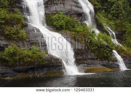 Two waterfalls side by side in the rainforest