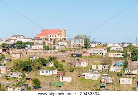 KNYSNA SOUTH AFRICA - MARCH 5 2016: A view of Queen of the Holy Rosary Catholic Church and houses and shacks in Khayalethu Township in Knysna