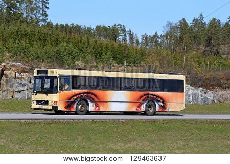 PAIMIO, FINLAND - MAY 6, 2016: A bus with wheels as eyes artwork moves along motorway in south of Finland.
