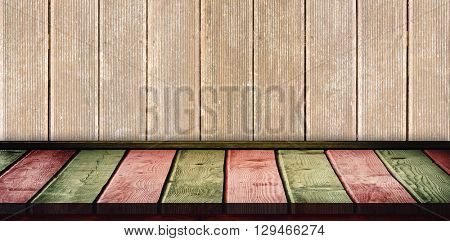 Red and khaki parquet against wooden planks