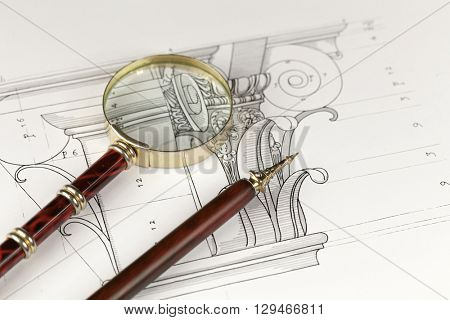 magnifying glass, vintage fountain pen & architectural drawing - detail column