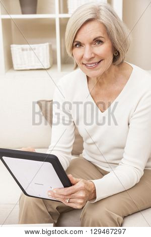 Senior woman using a tablet computer at home