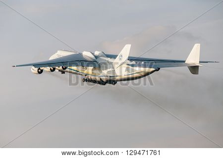 PRAGUE CZE - MAY 12: Antonov 225 Mriya airplane departs from Airport Vaclava Havla in Prague May 12 2016 PRAGUE CZECH REPUBLIC. The biggest airplane in the world.