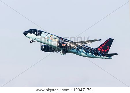 PRAGUE CZE - MAY 12: Brussels Airlines (Tintin comics Livery) Airbus A320-214 with identification OO-SNB takes off at Airport Vaclava Havla in Prague May 12 2016 PRAGUE CZECH REPUBLIC. Brussels Airlines is the flag carrier and largest airline of Belgium.