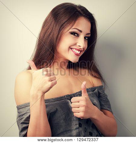 Happy Optimistic Brunette Woman Showing Thumb Up Sign. Toned Vintage Closeup Portrait