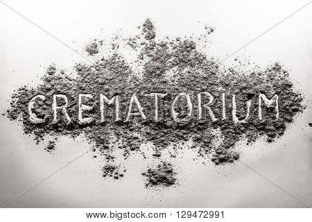 Crematorium crematory word written in grey ash dust cloud
