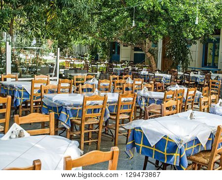 traditional greek outdoor restaurant. empty tables in tavern