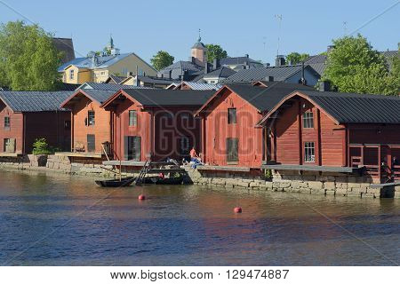 PORVOO, FINLAND - JUNE 13, 2015: Summer evening on the river Porvoonjoki. The old barns - the main attraction of Porvoo, Finland
