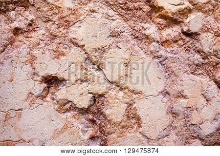 abstract texture of a stone of red color for natural backgrounds and for wallpaper