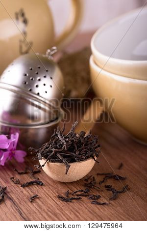 Wooden Spoon With Heap Of Dry Tea And Tea Set
