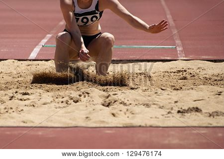 Landing in long jump in track and field
