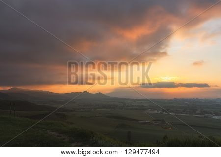 Cloudy sky at sunset over the city