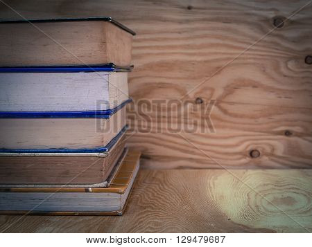 old book  Placed on a wooden floor. (vintage) (View with copy space)
