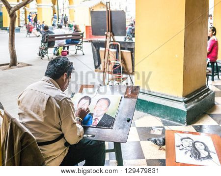 Lima, Peru - October 11 2014 - A man painting near the Plaza de Armas (main square) in Lima (Peru)