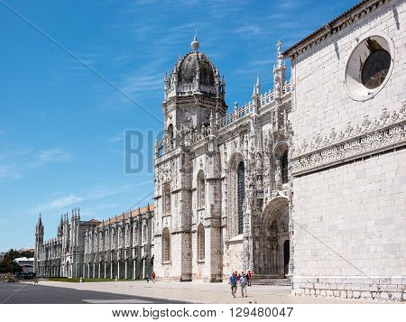 Belem, Portugal - April 28 2014: Main facade of the Jeronimos Monastery in Belem Portugal. It is a Manueline style monastery and part of the UNESCO World Heritage Sites.