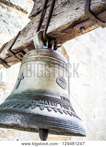 Figueres Spain - September 20 2014: A beautiful bell seen on the Mare de Deu del Mont sanctuary (Understandable Text: Manuel Roses foundry Valencia)