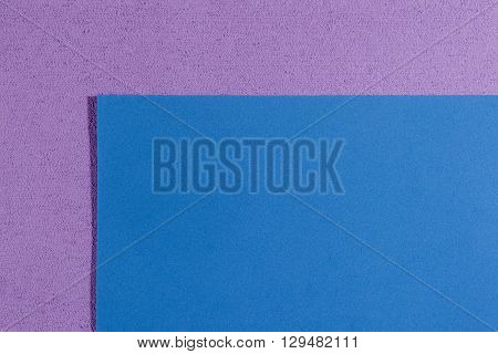 Eva foam ethylene vinyl acetate smooth blue surface on light purple sponge plush background
