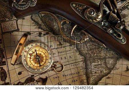 Ancient Map And Antique Handgun And Brass Compass