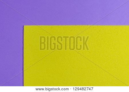 Eva foam ethylene vinyl acetate sponge plush lemon yellow surface on light purple smooth background