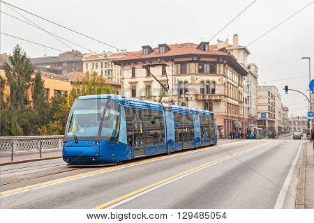 Blue tram on the street of Padua Italy