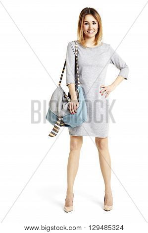 Cheerful Girl With A Bag On White Background