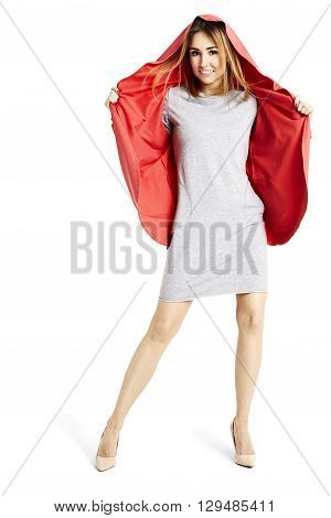 Cheerful Woman In Gray Dress And Red Cape