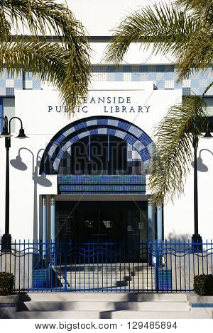 OCEANSIDE, UNITED STATES - DECEMBER 25: The entrance of the Oceanside Public Library decorated with colorful mosaic tiles and flanked by palm leaves on December 25, 2015 in Oceanside.