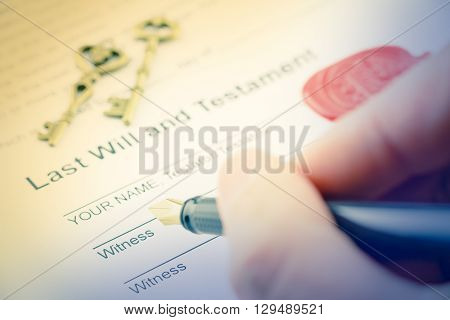 Vintage / retro style : Man's right hand with fountain pen preparing to sign a form of last will and testament. A form is sealed with sealing wax and stamped / embossed with alphabet letter B.