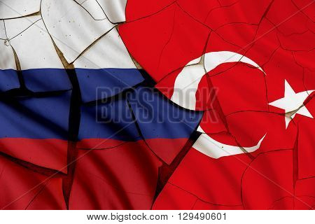 Flag of Turkey and Russia. A symbol of an armed conflict between Moscow and Ankara after Russian SU-34 fighter jet or air force plane reportedly flew into Turkish airspace despite radar warnings.