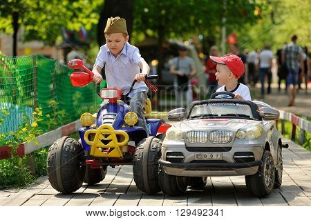 Orel Russia - May 9 2016: Celebration of 71th anniversary of the Victory Day (WWII). Children racing small cars closeup