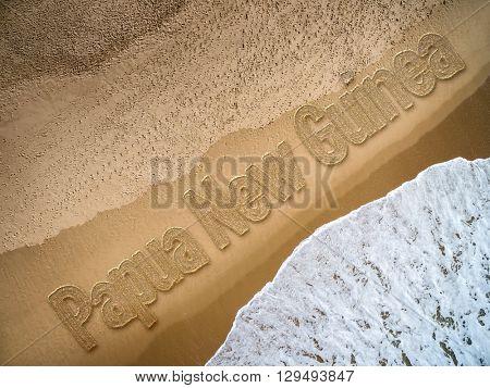 Papua New Guinea written on the beach