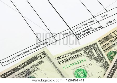 Payslip shows amount of earn with banknotes and coins