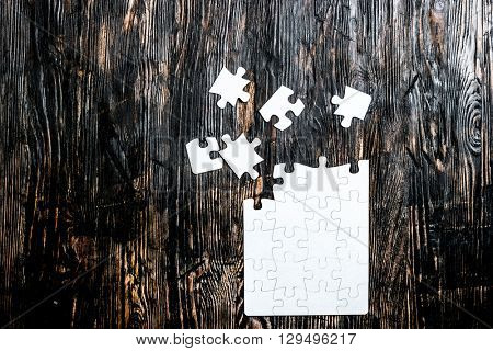 unfinished white puzzle with missing pieces