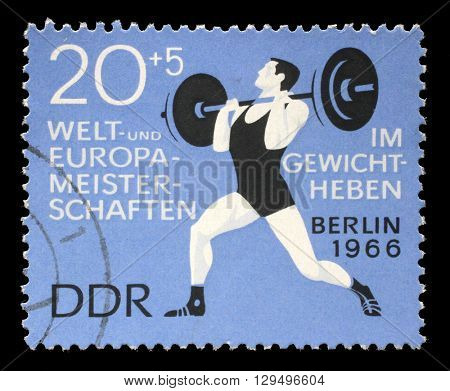 ZAGREB, CROATIA - JULY 02: A stamp printed in GDR (German Democratic Republic - East Germany) shows weightlifter, circa 1966, on July 02, 2014, Zagreb, Croatia