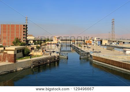 ESNA EGYPT - FEBRUARY 3 2016: Approaching the Ship locks in Esna and old dam on the Nile River Egypt