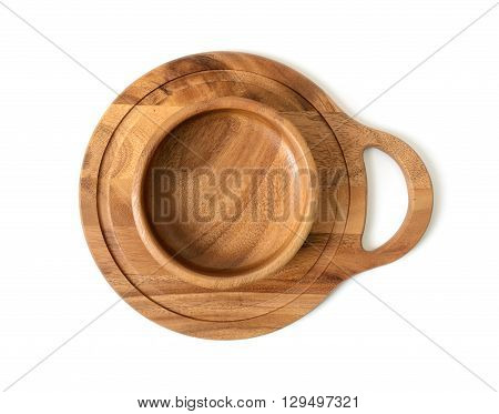 Cutout wooden bowl on a wooden chopping board. Top view. Wooden Tableware. Environmentally friendly goods. Durable material. Naturally beautiful goods. Strength material. Safe to use.