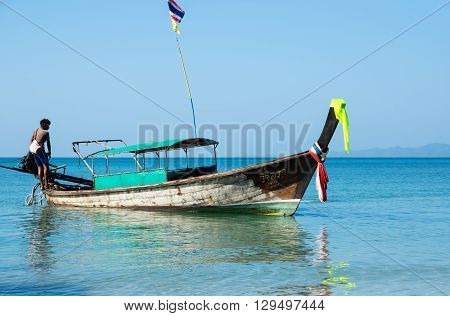 CRABI PROVINCE THAILAND - FEBRUARY 04 2015: Traditional thai long tail boat waiting for tourists to travel to beautiful islands in Thailand