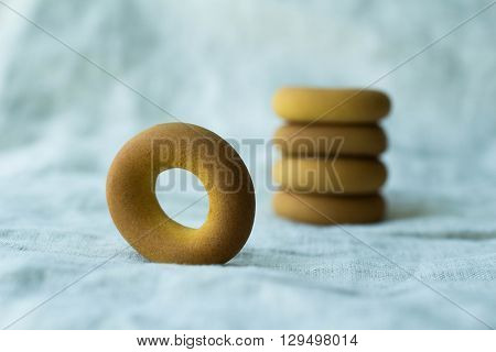 A handful of bagels on textile background. Bake on a linen background. A background for your postcard