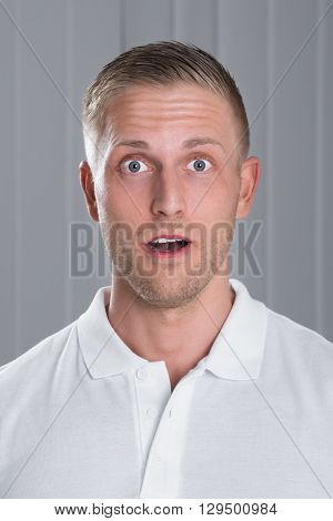 Portrait Of Surprised Young Handsome Man In White T-shirt
