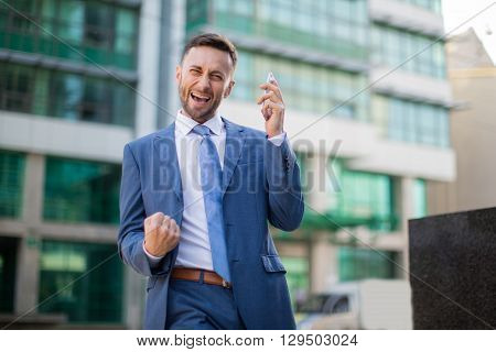 successful businessman winning,blurred background with copy space for content or design